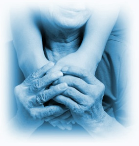 Caregiver and Loved One Holding Hands